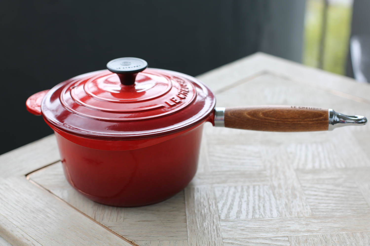 Le Creuset Heritage Wooden Handle Cast-Iron Saucepan. The wooden handle makes it comfortable to hold and keeps it cool to the touch. Perfect for stove-top cooking. I bought mine at Williams-Sonoma.