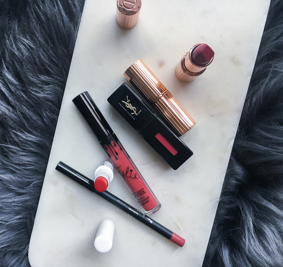 Charlotte Tilbury Matte Revolution Lipstick in Amazing Grace | Charlotte Tilbury 'Hop Lips' Lipstick in Secret Selma | YSL Vinyl Cream Lip Cream in 412 | Kylie Lip Kit in Kristen | Glossier Generation G lipstick in Zip