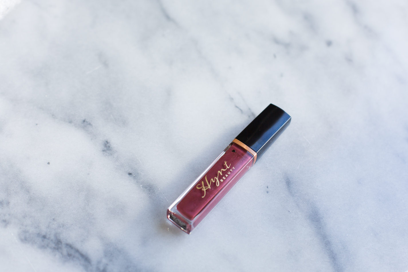 Hynt Beauty Lip Gloss in color Liquid Garnet